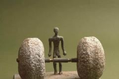 THE MAN AND THE BURDEN, 1973, bronze, granite